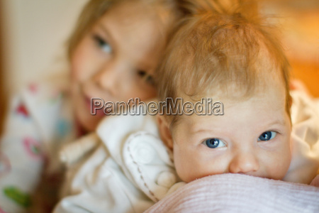 girl smiling with baby sister
