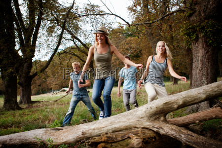 young persons running together in nature
