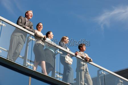 business people standing on walkway