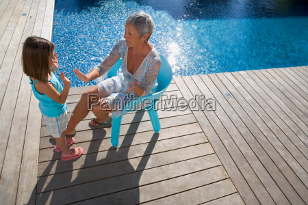 older woman playing with young girl