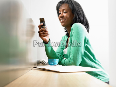 woman with coffee looking at her