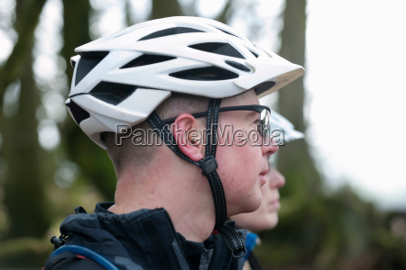 couple with bike helmets in countryside