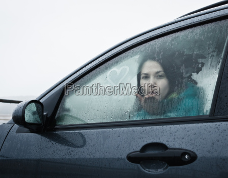 teenage, girl, blowing, kiss, from, car - 18359512