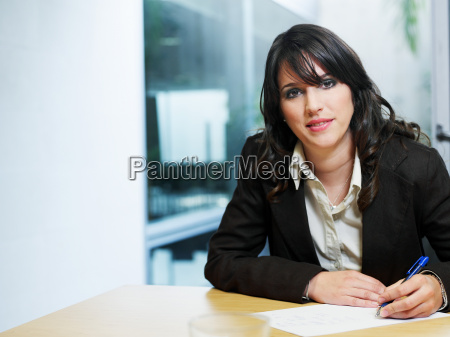 young businesswoman sitting in office