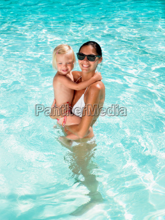 woman holding a young girl in