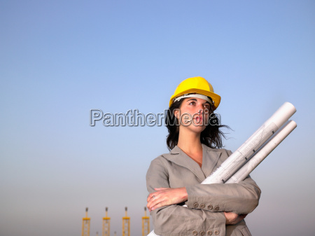 woman, in, hard, hat, holding, drafts - 18374070
