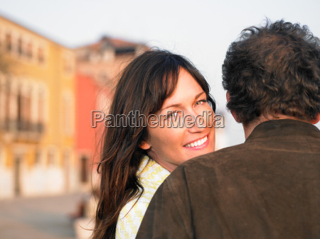 rear view of couple woman turning