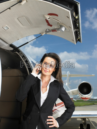 businesswoman outside of private jet