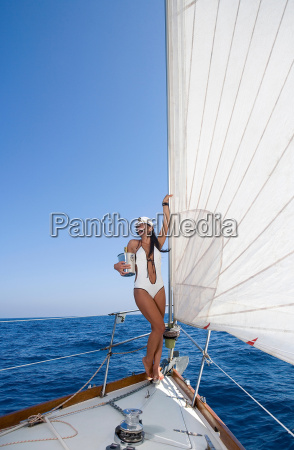 woman on sail boat with champagne