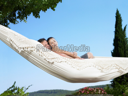 couple relaxing on hammock