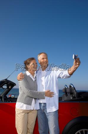 man and woman looking at sea