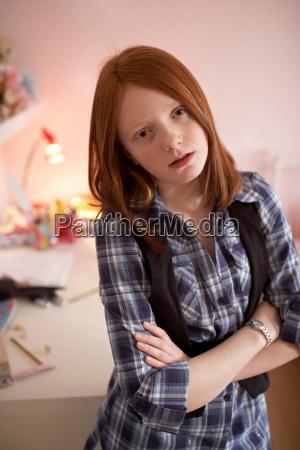 teenage girl looking cross