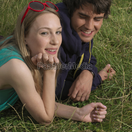 young woman and man lying in
