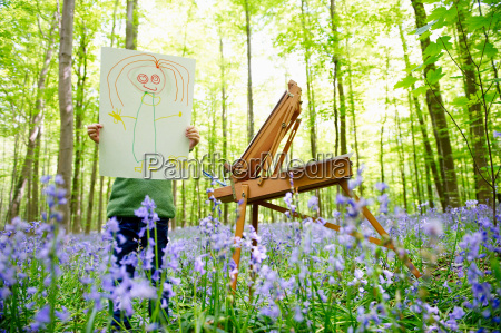 girl painting in the forest fun