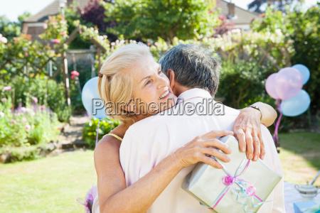 mature woman embracing mature man
