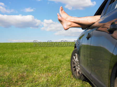 mans feet out of car window