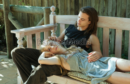 young man stroking young womans ear