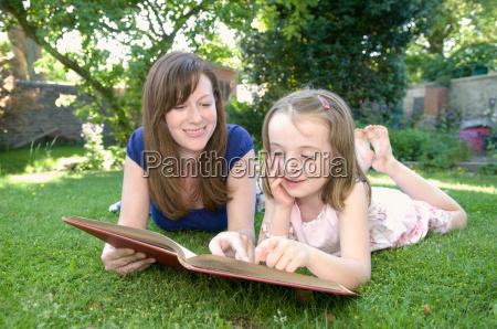 woman and child read from book