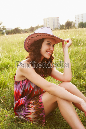 woman with cowboy hat sitting in