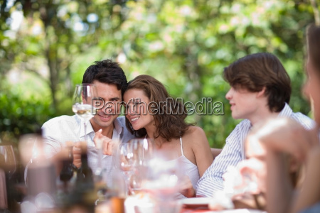 couple looking at a glass of