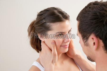 man holding his girlfriends face