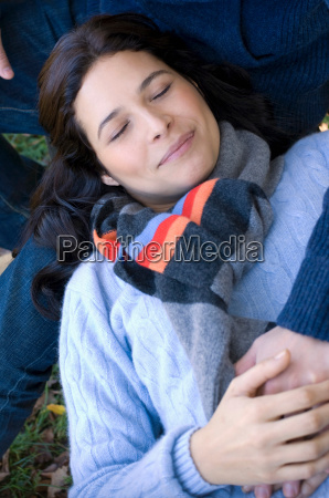 girl resting on mans lap