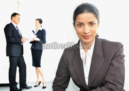 business women with colleagues in office