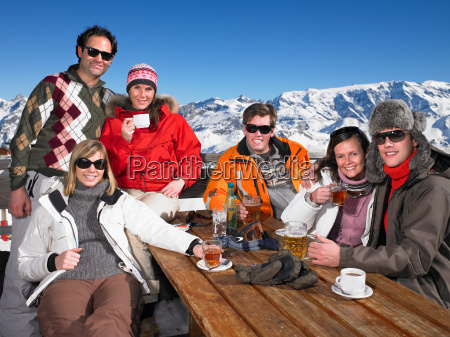 group of friends having drink on