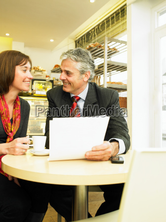 businesswoman and man holding documents