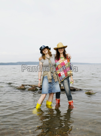two women standing in shallow water
