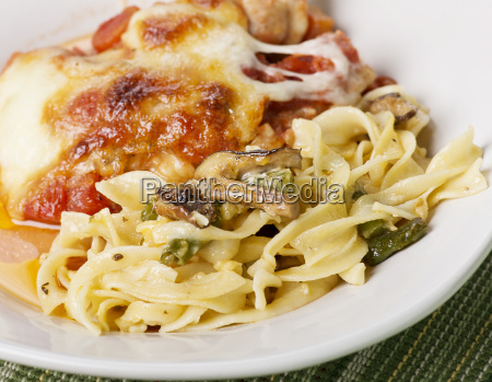 pasta with vegetables and parmesan chicken