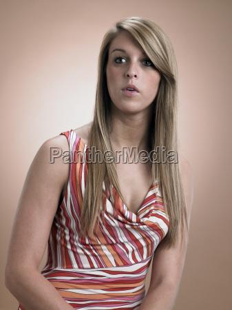 teenage girl looking awkward