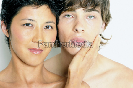woman placing hand on mans face