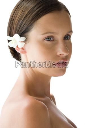 portrait of young woman with flower
