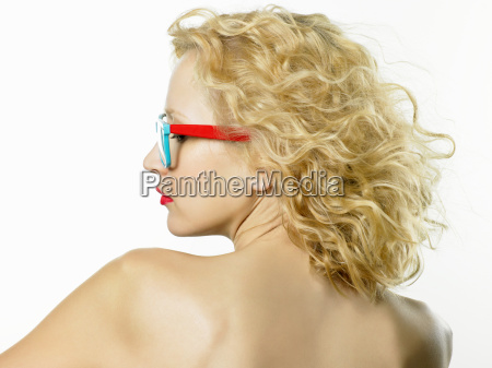 young woman wearing glasses rear view