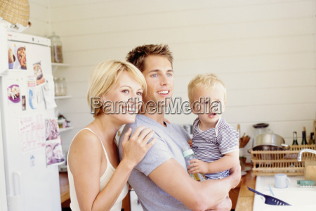 young parents with child in the