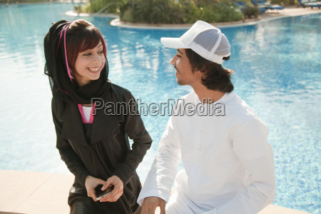 middle eastern people by swimming pool