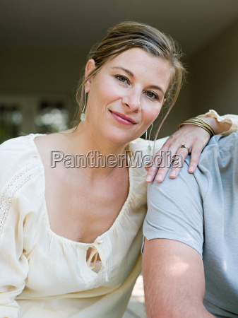 woman with hand on mans shoulder