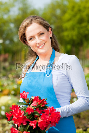 woman holding red flowers portrait