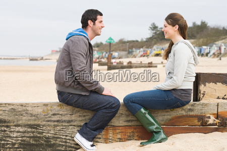 couple sitting on a fence at