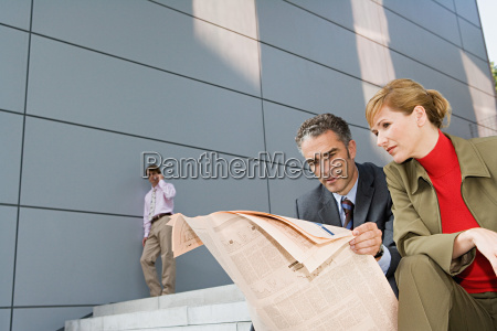 businesspeople outside office building