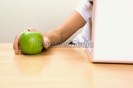 businesswoman holding an apple