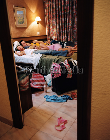 young people sleeping in hotel