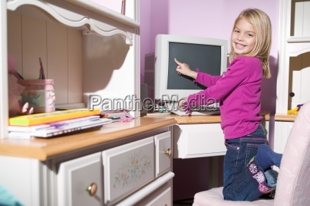 girl pointing at computer screen