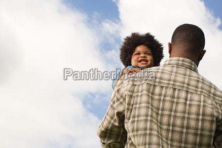 baby being carried by father