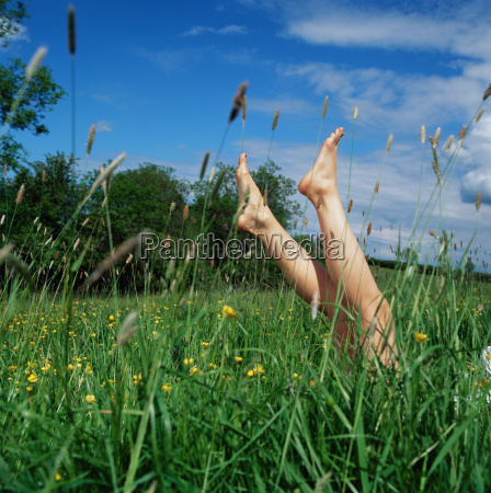 feet of woman in long grass