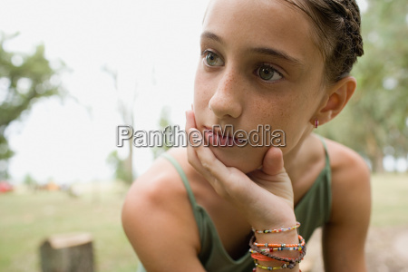 bored looking girl in a field
