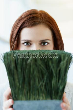 woman holding pot plant