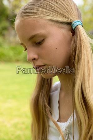 unhappy young girl outdoors