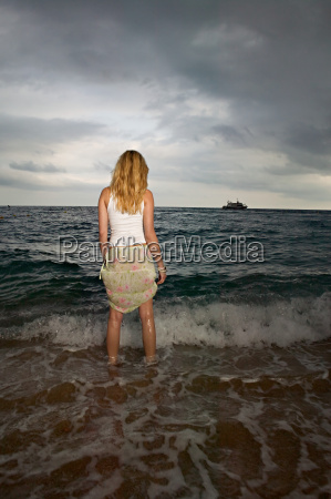 woman standing in the sea